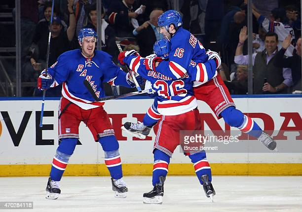Derick Brassard of the New York Rangers celebrates his powerplay goal at 316 of the third period against the Pittsburgh Penguins and is joined by...