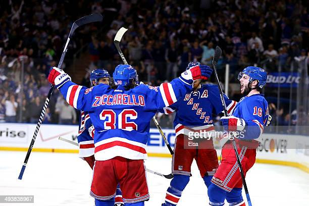 Derick Brassard of the New York Rangers celebrates with his teammates after scoring a goal late in th second period against Dustin Tokarski of the...