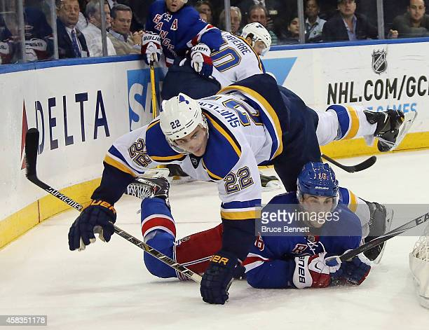 Derick Brassard of the New York Rangers is hit by Kevin Shattenkirk of the St Louis Blues during the second period at Madison Square Garden on...
