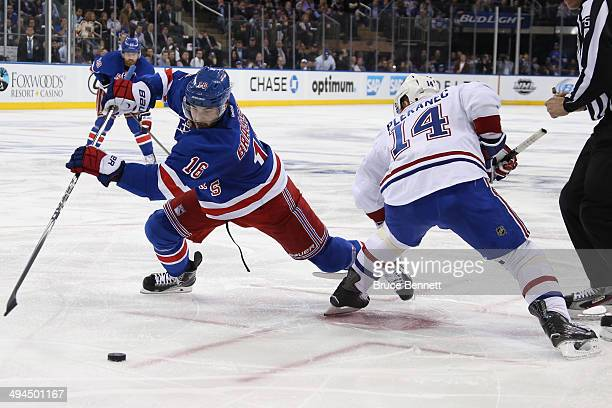 Derick Brassard of the New York Rangers plays the puck against Tomas Plekanec of the Montreal Canadiens during Game Six of the Eastern Conference...