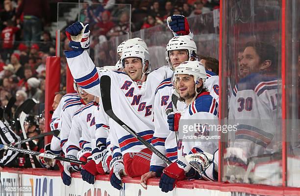 Derick Brassard of the New York Rangers raises his arms to celebrate a second period goal against the Ottawa Senators with teammates Benoit Pouliot...