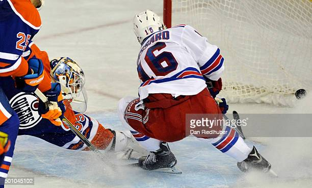 Derick Brassard of the New York Rangers scores a third period goal against goaltender Anders Nilsson of the Edmonton Oilers at Rexall Place on...