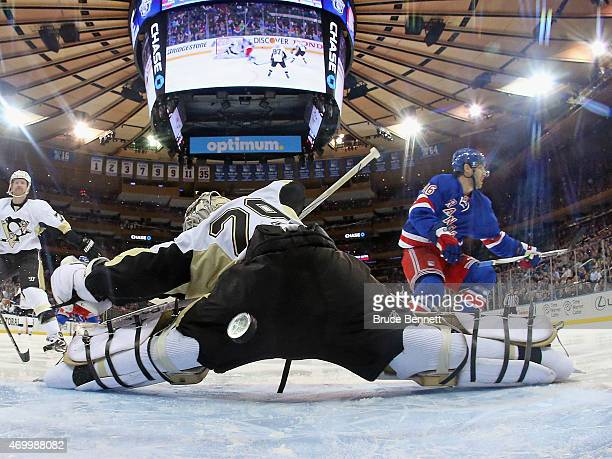 Derick Brassard of the New York Rangers scores at 28 seconds of the first period against MarcAndre Fleury of the Pittsburgh Penguins in Game One of...