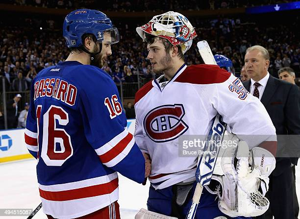 Derick Brassard of the New York Rangers shakes hands with Dustin Tokarski of the Montreal Canadiens after winning Game Six of the Eastern Conference...