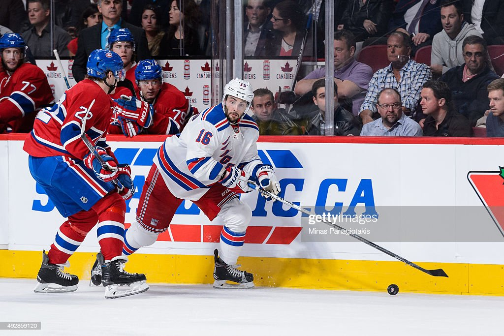 Derick Brassard #16 of the New York Rangers skates the puck against Dale Weise #22 of the Montreal Canadiens during the NHL game at the Bell Centre on October 15, 2015 in Montreal, Quebec, Canada. The Canadiens defeated the Rangers 3-0 and for the first time in franchise history, the Canadiens have won five games in a row to start the season.