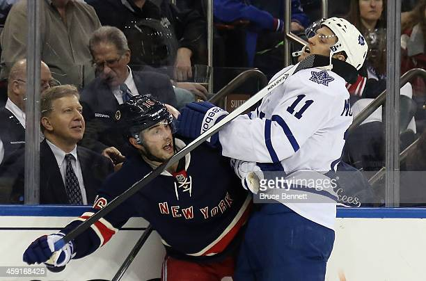 Derick Brassard of the New York Rangers takes a high sticking penalty against Jay McClement of the Toronto Maple Leafs in the first period at Madison...