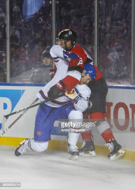 Derick Brassard of the Ottawa Senators battles for position against Jeff Petry of the Montreal Canadiens in the 2017 Scotiabank NHL100 Classic at...