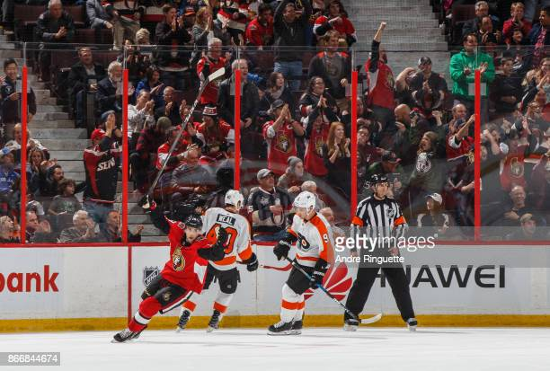 Derick Brassard of the Ottawa Senators celebrates a second period goal by Mark Stone as Jordan Weal and Ivan Provorov of the Philadelphia Flyers look...