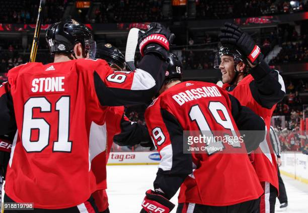 Derick Brassard of the Ottawa Senators celebrates his late third period goal against the Buffalo Sabres with team mates Mark Stone and Mike Hoffman...
