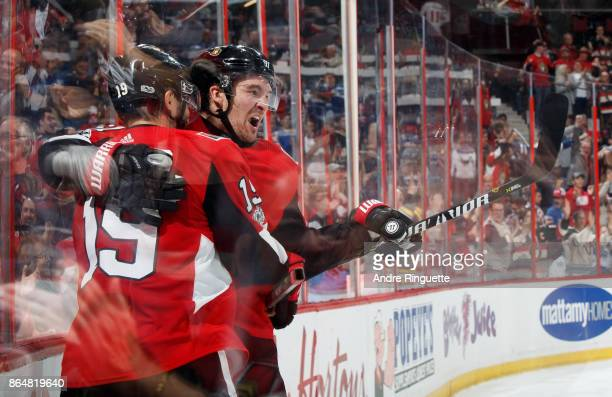 Derick Brassard of the Ottawa Senators celebrates his third period goal against the Toronto Maple Leafs with teammate Mark Stone at Canadian Tire...