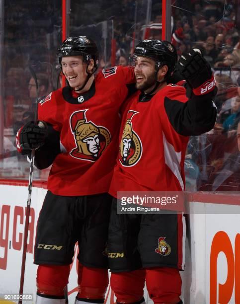Derick Brassard of the Ottawa Senators celebrates his third period goal against the San Jose Sharks with teammate Thomas Chabot at Canadian Tire...