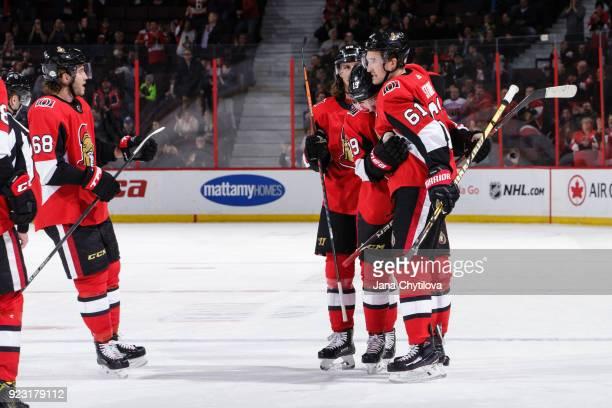 Derick Brassard of the Ottawa Senators celebrates his third period powerplay goal against the Tampa Bay Lightning with team mates Mike Hoffman Erik...