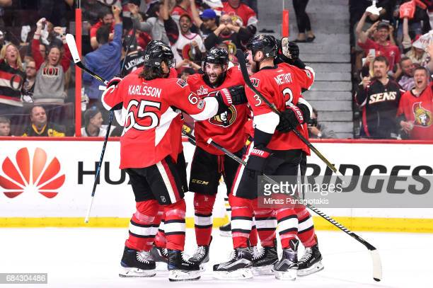 Derick Brassard of the Ottawa Senators celebrates with his teammates after scoring a goal against MarcAndre Fleury of the Pittsburgh Penguins during...