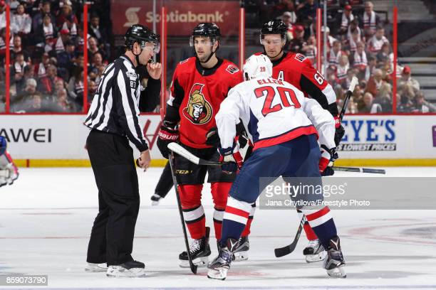 Derick Brassard of the Ottawa Senators looks at linesman Devin Berg as he takes a faceoff against Lars Eller of the Washington Capitals at Canadian...