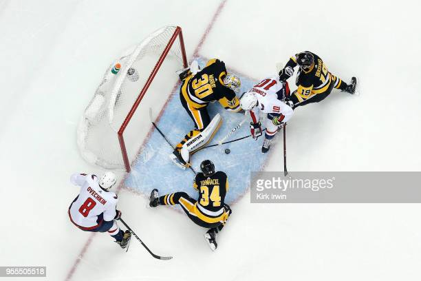 Derick Brassard of the Pittsburgh Penguins and Tom Kuhnhackl combine to help Matt Murray stop a shot from Brett Connolly of the Washington Capitals...