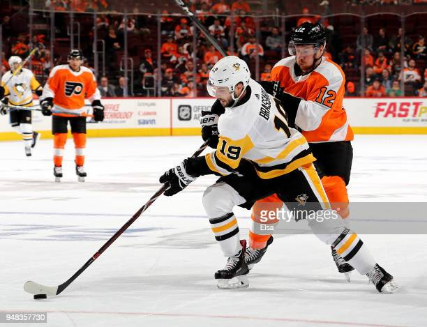 Derick Brassard of the Pittsburgh Penguins heads for the net as Michael Raffl of the Philadelphia Flyers defends in the third period of Game Four of...