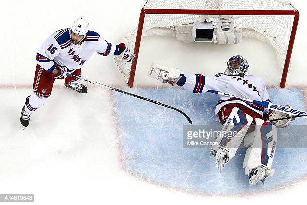 Derick Brassard shouts for a call as Henrik Lundqvist of the New York Rangers lays on the ground after JT Brown of the Tampa Bay Lightning tripped...