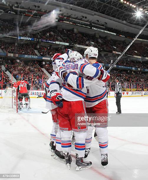 Derick Brassard the New York Rangers celebrates his second period goal against Robin Lehner of the Ottawa Senators with teammates at Canadian Tire...