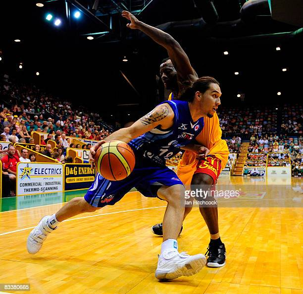 Derick Lowe of the Spirit attemts to drive past Corey Wiliamsof the Crocodiles during the round six NBL match between the Townsville Crocodiles and...