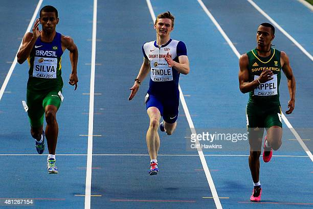 Derick Silva of Brazil Cameron Tindle of Great Britain and Kyle Appel of South Africa in action during the Boys 200 Meters Semi Final on day four of...