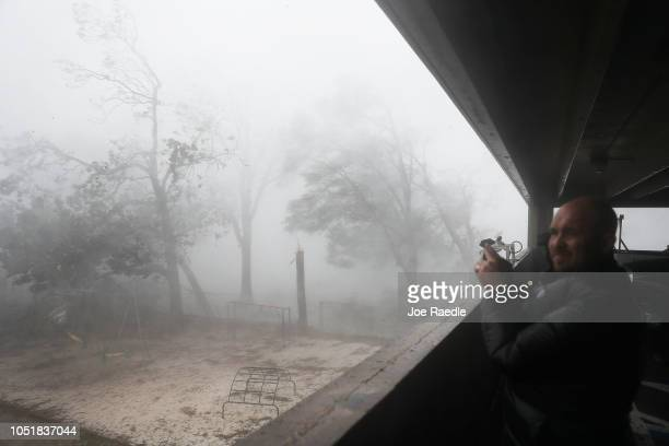 Derik Kline takes shelter in a parking garage as Hurricane Michael passes through the area on October 10 2018 in Panama City Florida The hurricane...