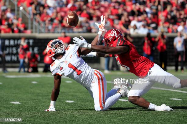 Derion Kendrick of the Clemson Tigers fumbles a punt return against the Louisville Cardinals at Cardinal Stadium on October 19 2019 in Louisville...