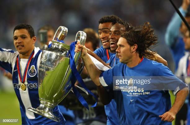 Derlei Jose Bosingwa Maniche and Richardo Costa of FC Porto celebrate winning the Champions League during the UEFA Champions League Final match...