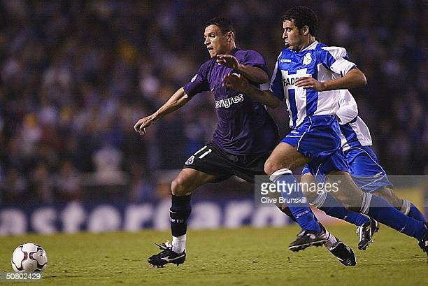 Derlei of Porto is tackled by Deportivos captain Nourredine Naybet during the UEFA Champions League Semi Final Second Leg match between Deportivo La...