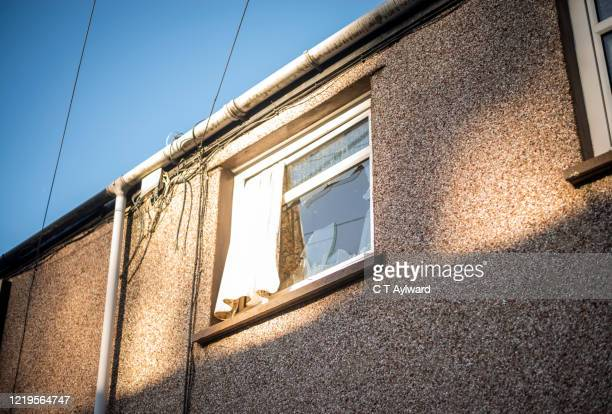 derlict house awaiting demolition with smashed window - aberfan stock pictures, royalty-free photos & images