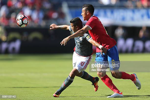Derlis Gonzalez of Paraguay and Oscar Duarte of Costa Rica challenge for the ball during the 2016 Copa America Centenario Group A match between Costa...