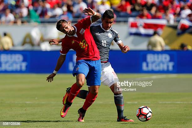 Derlis Gonzalez of Paraguay battles for the ball against Ronald Matarrita of Costa Rica during a group A match between Costa Rica and Paraguay at...