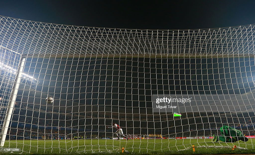 Derlis Gonzalez of Paraguay scores the fifth penalty kick in the penalty shootout during the 2015 Copa America Chile quarter final match between Brazil and Paraguay at Ester Roa Rebolledo Stadium on June 27, 2015 in Concepcion, Chile.