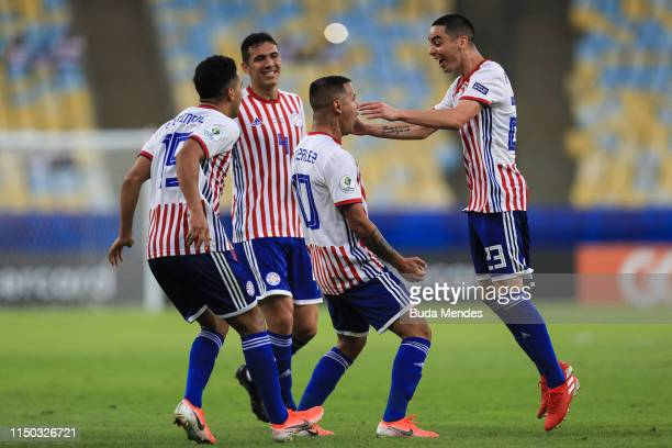Derlis González of Paraguay celebrates with his teammates after scoring the second goal of his team during the Copa America Brazil 2019 group B match...