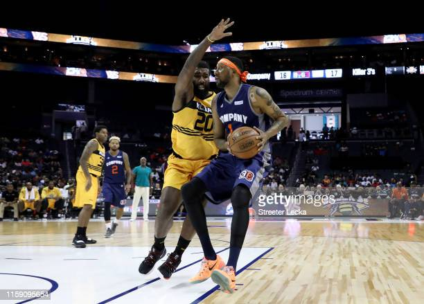 DerMarr Johnson of 3's Company drives to the basket against Donte Greene of Killer 3s during week two of the BIG3 three on three basketball league at...