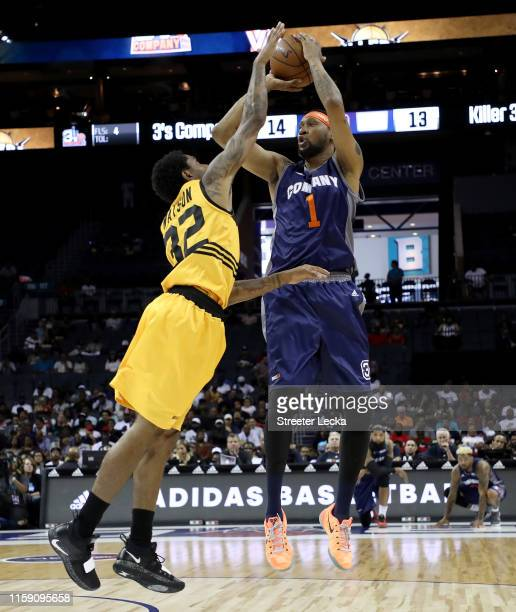 DerMarr Johnson of 3's Company shoots over C.J. Watson of Killer 3s during week two of the BIG3 three on three basketball league at Spectrum Center...