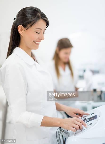 Dermatologist using ultrasound machines