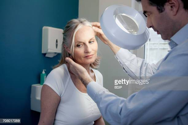 dermatology, symptomatology elderly person - skin cancer face stock photos and pictures