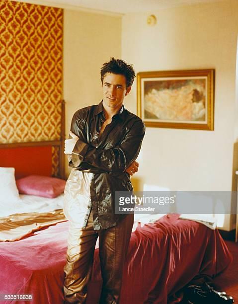 Dermot Mulroney Standing in a Bedroom