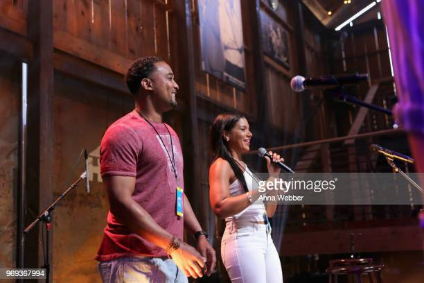 DeRon Jenkins and Page Turner of Flip or Flop Nashville speak onstage in the HGTV Lodge at CMA Music Fest on June 7 2018 in Nashville Tennessee