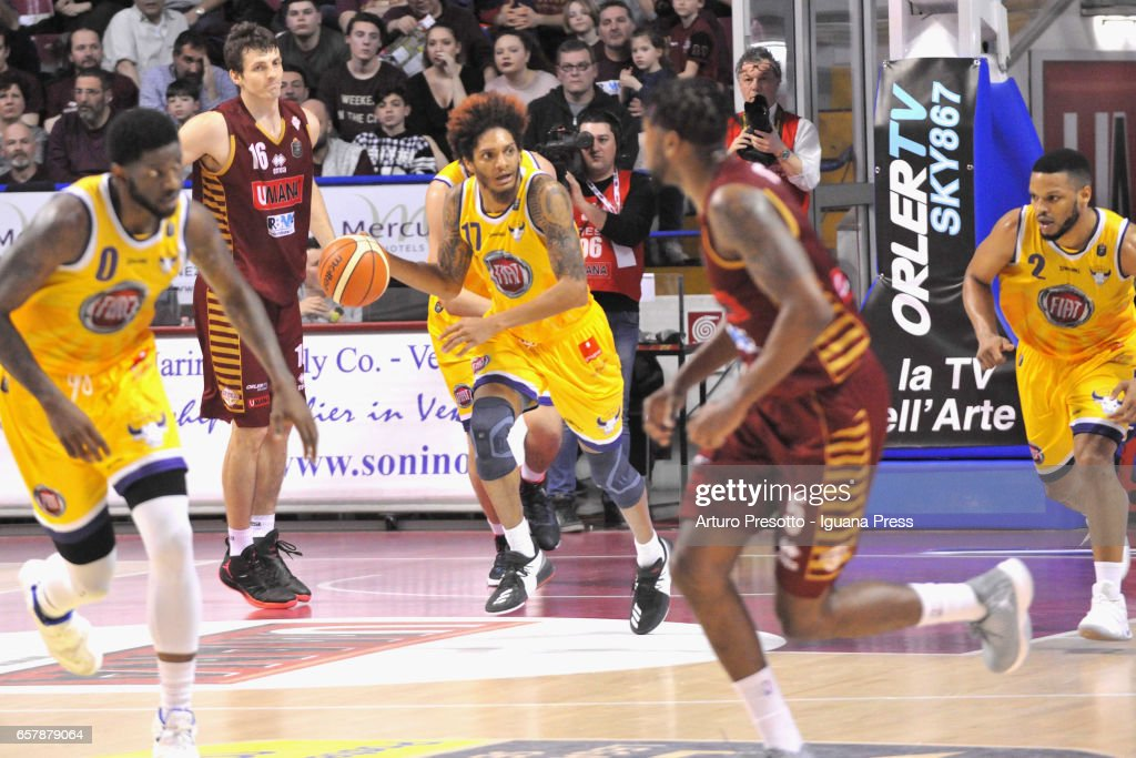 Deron Washington (C) of Fiat competes with Benjamin Ortner (L) and Melvin Ejim (R) of Umana during the LegaBasket LBA of Serie A1 match between Reyer Umana Venezia and Auxilium Fiat Torino at Palasport Taliercio on March 19, 2017 in Mestre, Italy.