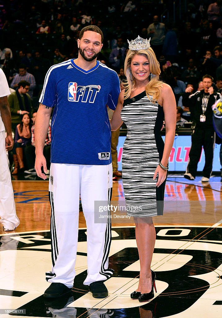 Deron Williams and Miss America Mallory Hagan pose together before the Miami Heat vs Brooklyn Nets game at Barclays Center on January 30, 2013 in the Brooklyn borough of New York City.