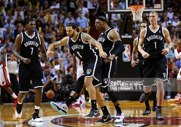 Deron Williams and Paul Pierce of the Brooklyn Nets celebrate a play during a game against the Miami Heat at American Airlines Arena on March 12 2014...