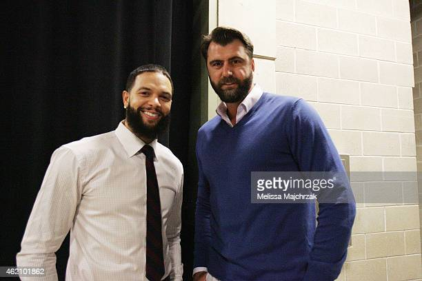 Deron Williams of the Brooklyn Nets and former Utah Jazz player Mehmet Okur before the game on January 24 2015 at EnergySolutions Arena in Salt Lake...