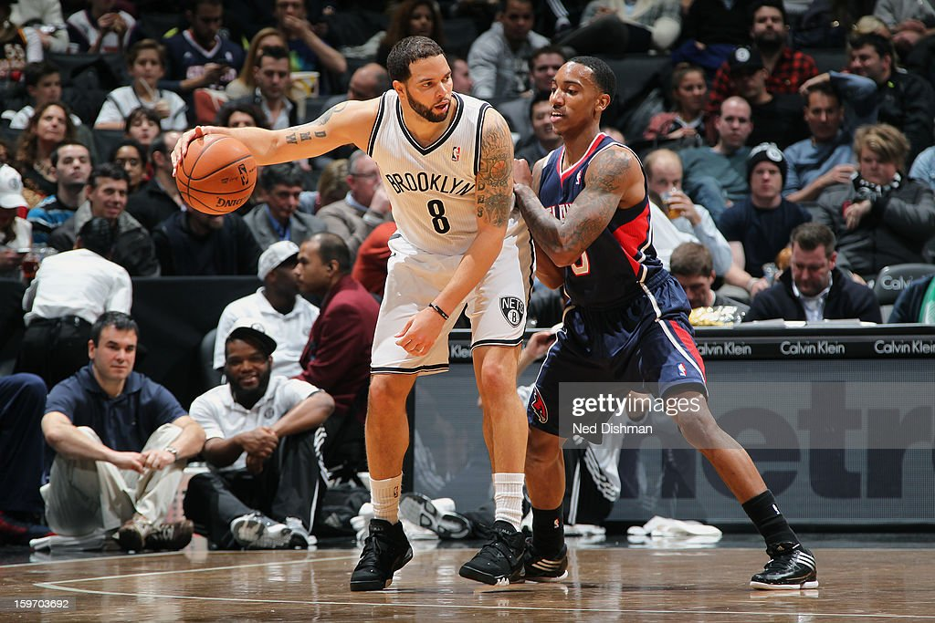 Deron Williams #8 of the Brooklyn Nets backs up to the basket against the Atlanta Hawks at the Barclays Center on January 18, 2013 in the Brooklyn borough of New York City in New York City.