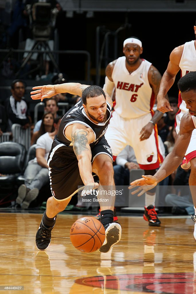 Deron Williams #8 of the Brooklyn Nets battles for a rebound against the Miami Heat at the American Airlines Arena in Miami, Florida on April, 8 2014.
