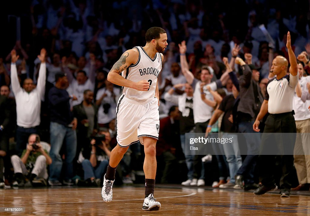 Deron Williams #8 of the Brooklyn Nets celebrates his three point shot in the fourth quarter against the Toronto Raptors in Game Six of the Eastern Conference Quarterfinals during the 2014 NBA Playoffs at the Barclays Center on May 2, 2014 in the Brooklyn borough of New York City.