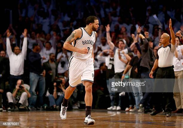 Deron Williams of the Brooklyn Nets celebrates his three point shot in the fourth quarter against the Toronto Raptors in Game Six of the Eastern...