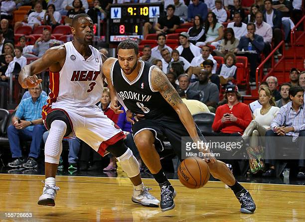 Deron Williams of the Brooklyn Nets drives against Dwyane Wade of the Miami Heat during a game at AmericanAirlines Arena on November 7 2012 in Miami...