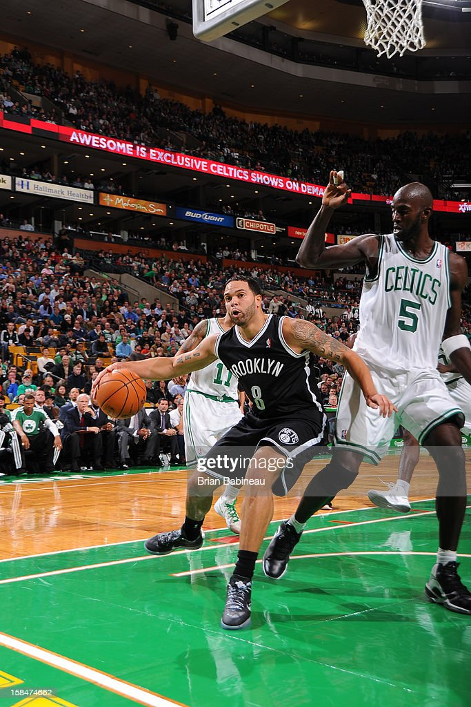 Deron Williams #8 of the Brooklyn Nets drives against Kevin Garnett #5 of the Boston Celtics on November 28, 2012 at the TD Garden in Boston, Massachusetts.
