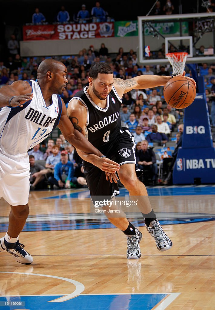 Deron Williams #8 of the Brooklyn Nets drives against Mike James #13 of the Dallas Mavericks on March 20, 2013 at the American Airlines Center in Dallas, Texas.